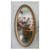 "Ornate framed oval mirror. 20""×36""."