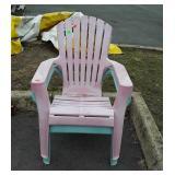 Two plastic Adirondack chairs