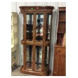 "Lighted curio cabinet with glass shelves 73"" tall"