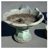 Two piece concrete bird bath, top is 33 inches in
