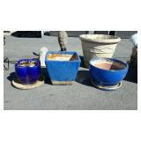 Three blue flower pots