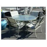 Round glass top patio table with four chairs 48