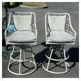 Two swivel patio bar stools