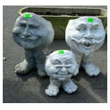 Three faces with feet planters