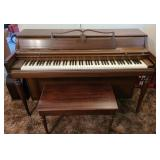 Wurlitzer piano with a stool