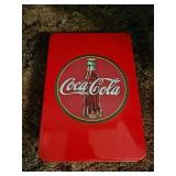 Vintage Coca-Cola tin box with collectibles