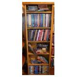 Bookshelf Full of DVD Movies, VHS Movies, & CD
