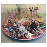 Plastic platter with shot glasses, corks and more