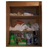 Cabinet Full of Laundry Detergent & Towels