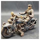 Vintage cast iron man on a motorcycle