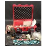 Red invicta case with jewelry, car meter, ect