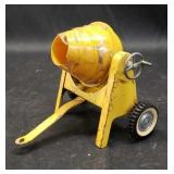 Beautiful vintage yellow metal cement roller toy