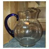 Beautiful glass pitcher with cobalt blue handle