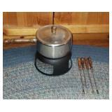 Beautiful metal Fondue pot with utensils