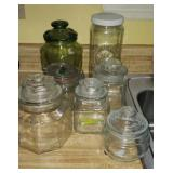 Lot of 7 glass jars with lids,