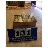 Cardboard box full of milkshake glasses