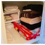 Towels, Quilt and Linen in Closet