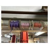 Assorted rolls of wire over door