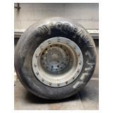 McCreary 25.5/10.0-13GTW wheel bent on back