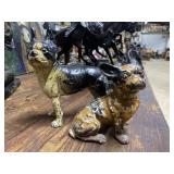 Two Cast metal bull dog door stops - one seated &