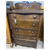 Five drawer upright dresser with fleur backsplash