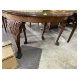 Claw footed oval dining table with leaf and highly
