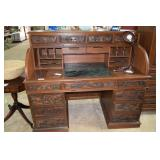 Very ornately carved roll top desk