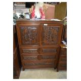 Teak oriental carved front bachelors chest