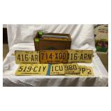 22 Assorted License Plates in a Wooden Crate