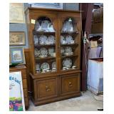 4 door China hutch.Dome shaped glass inserts on