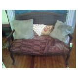 Antique Settee With Pillows