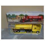 2) Metal Tanker Trucks