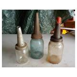3 glass oil bottles with spouts