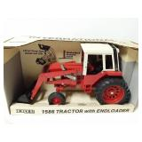 International 1586 tractor with end loader. 1/16