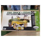 John Deere fire truck pedal car. New in box