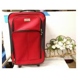 Protégé carry on rolling luggage and welcome