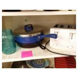 Cast iron pan, blue jar l, frying pan and toaster