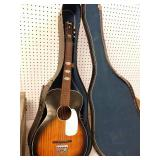 Stella acoustic guitar and case. Back has a crack