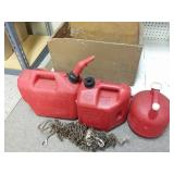 Wood crate, 3 gas cans and chain