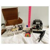 Polaroid camera with accessories