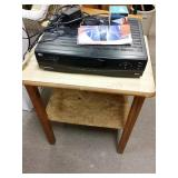 Table with DVD player