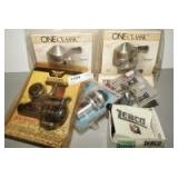 VINTAGE FISHING REELS IN ORIGINAL PACKAGES INCLUDING ZEBCO ONE CLASSIC, ZEBCO 33, FENWICK BLACKHAWK SPINNING REEL, AND SHAKESPEARE OMNI SPINNING REEL