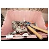 STORAGE TUB FILLED WITH TOOLS INCLUDING VINTAGE JIGSAW, GLASS BOTTLE PAINT SPRAYER, SHEARS, HATCHET, OIL FILTER TOOLS, PRUNING SAW, AND MORE
