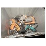 STORAGE BIN FILLED WITH TOOLS INCLUDING RIDGID CORDLESS NAIL GUN, DRILLS, AND MORE