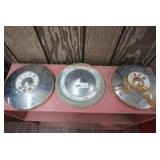 PAIR OF MID-CENTURY FORD HUBCAPS AND SINGLE MID-CENTURY CHEVROLET HUBCAP
