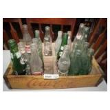 OLD YELLOW COCA-COLA CRATE WITH VINTAGE AND ANTIQUE BOTTLES