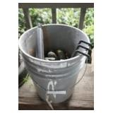 FIVE GALLON BUCKET FULL OF GARDEN TOOLS, TAPE MEASURE, TIN SNIPS, AND MORE