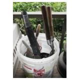 FIVE GALLON BUCKET WITH GARDEN TOOLS, ELECTRIC FENCE TRANSFORMERS, ELECTRIC FENCE CABLE, AND MORE