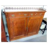 Chippendale mahogany cabinet with brass gallery