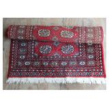Several floor rugs